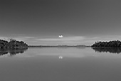 Pará State, Brazil. Xingu River. Single cloud reflected in the river.