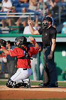 Umpire Tyler Witte calls a strike behind catcher Andres Sthormes (44) during a NY-Penn League game between the State College Spikes and Batavia Muckdogs on July 3, 2019 at Dwyer Stadium in Batavia, New York.  State College defeated Batavia 6-4.  (Mike Janes/Four Seam Images)