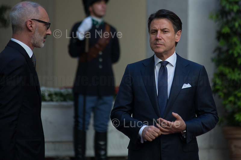 (On the R) Giuseppe Conte (Italian Prime Minister). <br /> <br /> Rome, 04/07/2019. Today, the four-time President of the Russian Federation, Vladimir Putin, visited Palazzo Chigi (Official Residence of the Italian Prime Minister and official meeting place of the Council of the Ministers) where he had a private meeting and a press conference with the Italian Prime Minister, Giuseppe Conte. During his visit to Italy, President Putin met Pope Francis, the President of the Italian Republic, Sergio Mattarella, and his old friend and Italian politician, Silvio Berlusconi.   <br /> <br /> Footnotes and Links:<br /> For a Video of the Press Conference please click here (Source, Palazzo Chigi on Youtube): https://youtu.be/4Bdssi0L9PI