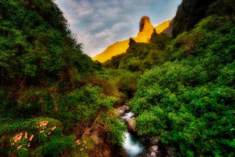 Iao Needle and stream at sunrise. Iao Valley State Park, Maui, Hawaii.
