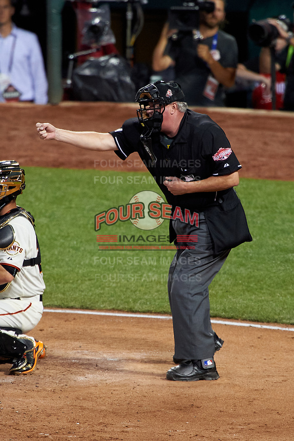 Umpire Tim Welke calls a strike during the MLB All-Star Game on July 14, 2015 at Great American Ball Park in Cincinnati, Ohio.  (Mike Janes/Four Seam Images)