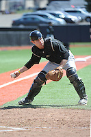University of Cincinnati Bearcats catcher Woody Wallace (10) during practice before a game against the Rutgers University Scarlet Knights at Bainton Field on April 19, 2014 in Piscataway, New Jersey. Rutgers defeated Cincinnati 4-1.  (Tomasso DeRosa/ Four Seam Images)