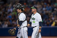 Hillsboro Hops manager Shawn Roof (44) walks towards the dugout with catcher Zachary Jones (40) after a visit on the pitcher's mound during a Northwest League game against the Salem-Keizer Volcanoes at Ron Tonkin Field on September 1, 2018 in Hillsboro, Oregon. The Salem-Keizer Volcanoes defeated the Hillsboro Hops by a score of 3-1. (Zachary Lucy/Four Seam Images)