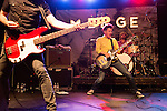 July 24, 2014. Carrboro, North Carolina.<br /> (left to right) Jason Narducy, Mac McCaughan and Jon Wurster of Superchunk headlined Thursday night. McCaughan is also the co-founder of MERGE Records, with Laura Ballance,<br />  Day two of the MERGE 25 festival, celebrating the 25 year history of the independent record label.