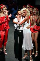 Roma 27/1/2004 <br /> Alta Moda Roma - Haute Couture - Fashion<br /> Dress collection of stylist Laura Pieralisi, collection inspired by Marylin Monroe.<br /> In this picture Laura Pieralisi, the stylist, with the showgirl Matilde Brandi.<br /> Foto Andrea Staccioli Insidefoto