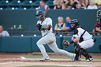 Luis Santos (6) of the Hudson Valley Renegades follows through on his swing against the Winston-Salem Dash at Truist Stadium on August 28, 2021 in Winston-Salem, North Carolina. (Brian Westerholt/Four Seam Images)