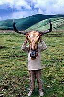 Kham, Tibet 2005. Boy wearing cowskull, Litang, Kham, eastern Tibet, 2005