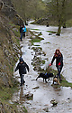 31/03/15<br /> <br /> Walkers brave their way along the edge of the river Dove as gale force winds and torrential rain makes the river flood over the paths and the famous Stepping Stones in Dovedale, in the Derbyshire Peak District.<br /> <br /> All Rights Reserved: F Stop Press Ltd. +44(0)1335 418629   www.fstoppress.com.