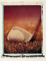 Close up, sepia image of a golf ball and 9-iron.
