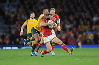 Kurtley Beale of Australia tackles Gareth Davies of Wales from behind during Match 35 of the Rugby World Cup 2015 between Australia and Wales - 10/10/2015 - Twickenham Stadium, London<br /> Mandatory Credit: Rob Munro/Stewart Communications