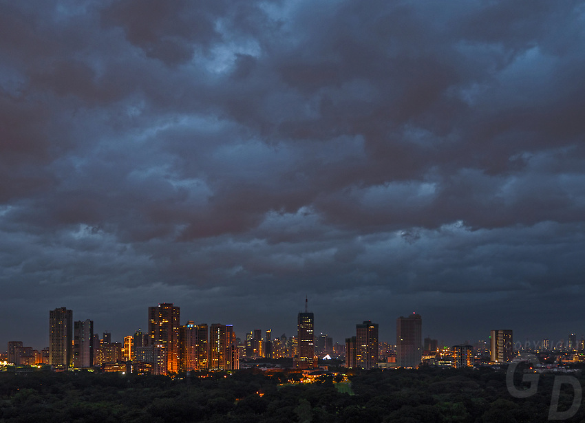 Cloudy night and architecture and high rise Buildings, Manila, Philippines