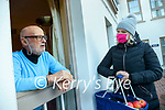 Fiona Carroll delivering groceries to Denis Tangney at his home in Bridewell lane in Killarney.