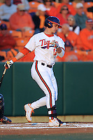 Clemson Tigers  first baseman Jon McGibbon #12 swings at a pitch during a game against the Virginia Cavaliers  at Doug Kingsmore Stadium on March 15, 2013 in Clemson, South Carolina. The Cavaliers won 6-5.(Tony Farlow/Four Seam Images).
