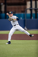 Michigan Wolverines shortstop Riley Bertram (12) warms up before the NCAA baseball game against the Michigan State Spartans on May 7, 2019 at Ray Fisher Stadium in Ann Arbor, Michigan. Michigan defeated Michigan State 7-0. (Andrew Woolley/Four Seam Images)