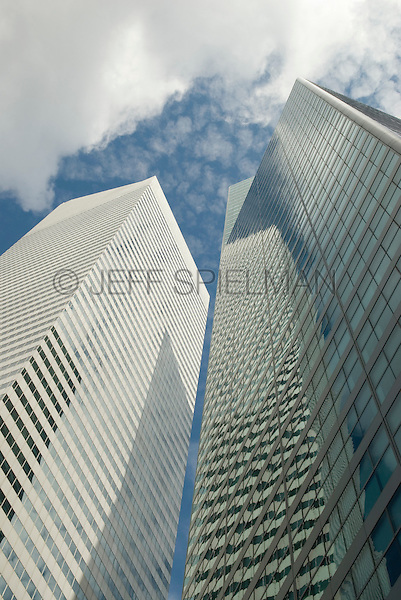 Upward View of Office Buildings and Clouds in Midtown Manhattan, New York City, New York State, USA<br /> <br /> AVAILABLE FOR LICENSING FROM GETTY IMAGES.  Please go to www.gettyimages.com and search for image # 162293656.