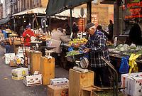 AJ3524, Philadelphia, outdoor market, Pennsylvania, Man selling fresh produce at the Italian Market in Philadelphia in the state of Pennsylvania.