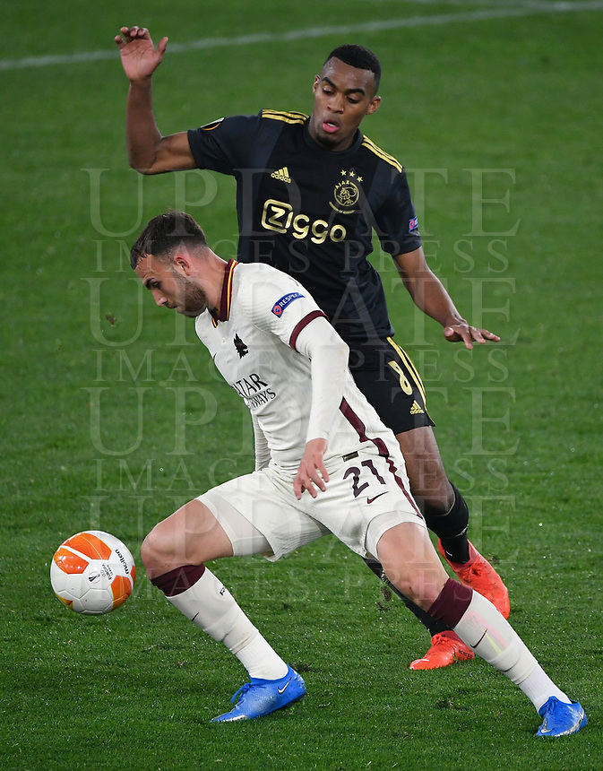Football: Europa League - quarter final 2nd leg AS Roma vs Ajax, Olympic Stadium. Rome, Italy, March 15, 2021.<br /> Roma's Borja Mayoral (in front of) in action with Ajax's Ryan Gravenberch (behind) during the Europa League football match between Roma at Rome's Olympic stadium, Rome, on April 15, 2021.  <br /> UPDATE IMAGES PRESS/Isabella Bonotto
