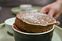 Melbourne, July 21, 2018 - The Chocolate Souffle from the Salon Paul Bocuse menu at Philippe Restaurant in Melbourne, Australia. Photo Sydney Low