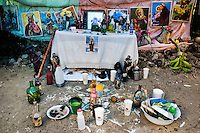 A sacred ritual altar seen during the Voodoo ceremony in Saut d'Eau, Haiti, July 16, 2008. Every year in summer thousands of pilgrims from all over Haiti make the religious journey to the Saut d'Eau waterfall (100km north of Port-au-Prince). It is believed that 150 years ago the spirit of Virgin Mary (Our Lady of Mount Carmel) has appeared on a palm tree close to the waterfall. This place became a main pilgrimage site in Haiti since then. Haitians wearing only underwear perform a bathing and cleaning ritual under the 100-foot-high waterfall. Voodoo followers (many Haitians practise both voodoo and catholicism) hope that Erzulie Dantor, the Voodoo spirit of water, manifest itself and they get possessed for a short moment, touched by her presence.