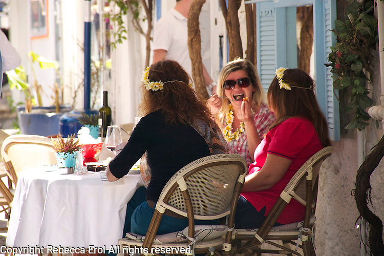 Turkish women in Alacati, Turkey, during the town's Ot Festivali (Herb Festivali) - re the garlands in their hair