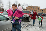Matthew carries Marianne and Katelyn in their church parking lot as Sarah follows behind with Benjamin and Nathan. Devoted Catholics, they attend church every Sunday and Matthew also teaches Sunday school.