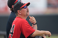 Hickory Crawdads bench coach Brian Dayett #24 watches a foul ball at L.P. Frans Stadium June 21, 2009 in Hickory, North Carolina. (Photo by Brian Westerholt / Four Seam Images)
