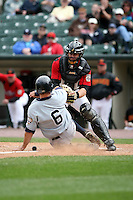 June 1st 2008:  Catcher Ryan Jorgensen of the Rochester Red Wings, Class-AAA affiliate of the Minnesota Twins, blocks the plate as Brett Gardner (6) of the Scranton Wilkes-Barre Yankees slides in during a game at Frontier Field in Rochester, NY.  Photo By Mike Janes/Four Seam Images