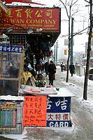 Jan 24, 2005 Toronto (Ontario) CANADA<br /> Toronto Chinatown  outdor stalls remain open despite falling snow , Jan 24, 2005 in Toronto, canada<br /> Photo (c) 2005 P Roussel / Images Distribution