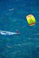 A kitesurfer kitesurfing on the north shore of Maui
