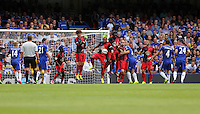 Pictured: Cesc Fabregas of Chelsea takes a free kick (4) which hits the Swansea wall. Saturday 13 September 2014<br /> Re: Premier League Chelsea FC v Swansea City FC at Stamford Bridge, London, UK.