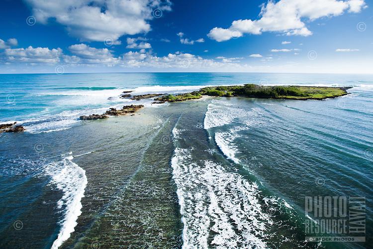An aerial perspective of waves breaking along Kapapa Island near the Kane'ohe Sandbar and Chinaman's Hat, Windward O'ahu.