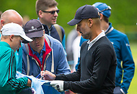Tommy Fleetwood (England) signs a Man City shirt during the BMW PGA PRO-AM GOLF at Wentworth Drive, Virginia Water, England on 23 May 2018. Photo by Andy Rowland.