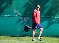 Landon Donovan walks on the field before training in Hamburg, Germany, for the 2006 World Cup, June, 8, 2006.