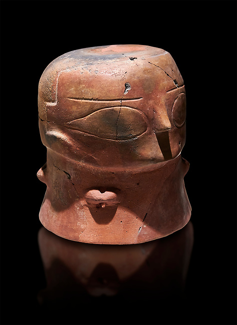 Terracotta Vase with female face. Catalhoyuk Collections. Museum of Anatolian Civilisations, Ankara. Against a black background