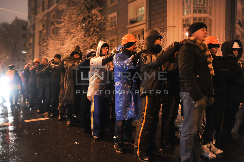 Organized group of activists are preparing to march on barricades.  Tonight the  police is expected to forcedly evacuate the streets from the protesters blocking all the government buildings. Kiev. Ukraine.