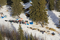 Aerial of volunteers at the Ophir checkpoint lined up for a group photo taken from the air on Thursday afternoon during Iditarod 2008