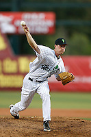 "Michael Kelly #35 of the Eugene Emeralds wears a ""Springfield"" throwback uniform while pitching against the Vancouver Canadians at PK Park on July 26, 2013 in Eugene, Oregon. Vancouver defeated Eugene, 4-3. (Larry Goren/Four Seam Images)"