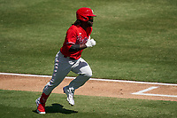 Philadelphia Phillies Odubel Herrera (37) runs to first base during a Major League Spring Training game against the Baltimore Orioles on March 12, 2021 at the Ed Smith Stadium in Sarasota, Florida.  (Mike Janes/Four Seam Images)