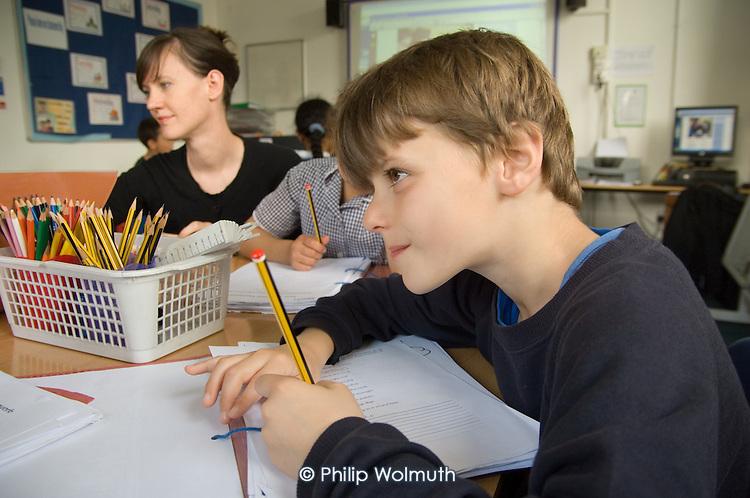 Teacher Rachel Poulton runs an after-school homework club for Year 3 and 4 pupils at St.Peter's C of E Primary School, Paddington, London.