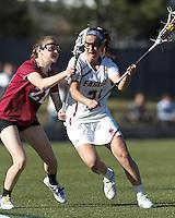 Boston College midfielder Caroline Margolis (21) on the attack as Harvard University midfielder Audrey Todd (21) defends.