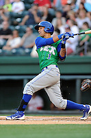 Shortstop Humberto Arteaga (1) of the Lexington Legends bats in a game against the Greenville Drive on Thursday, April 24, 2014, at Fluor Field at the West End in Greenville, South Carolina. Greenville won, 9-4. (Tom Priddy/Four Seam Images)