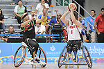 November 18 2011 - Guadalajara, Mexico:   Adam Lancia of Team Canada looks to make a pass in the CODE Alcalde Sports Complex at the 2011 Parapan American Games in Guadalajara, Mexico.  Photos: Matthew Murnaghan/Canadian Paralympic Committee