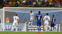 Phil Jagielka of England heads the ball off his goal line after a chip from Mario Balotelli of Italy