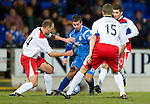 St Johnstone v Inverness Caley Thistle....02.01.11  .Peter MacDonakd is surrounded by Chris Innes, Grant Munro and Graeme Shinnie.Picture by Graeme Hart..Copyright Perthshire Picture Agency.Tel: 01738 623350  Mobile: 07990 594431