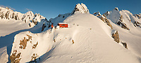 Mountaineers arriving at alpine shelter, Centennial Hut in upper parts of  Franz Josef Glacier at winter sunset, Westland Tai Poutini National Park, West Coast, UNESCO World Heritage Area, New Zealand, NZ