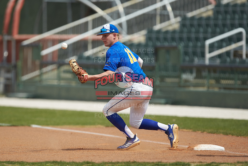 Mars Hill Lions first baseman Scottie Lee (11) can't handle a throw during the game against the Queens Royals at Intimidators Stadium on March 30, 2019 in Kannapolis, North Carolina. The Royals defeated the Bulldogs 11-6 in game one of a double-header. (Brian Westerholt/Four Seam Images)