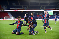 24th December 2020; Paris, France; French League 1 football, Paris St Germain versus Strasbourg;   Goal celebrations from IDRISSA GUEYE PSG with BIOTY MOISE KEAN PSG  TIMOTHEE PEMBELEand MARCO VERRATTI PSG