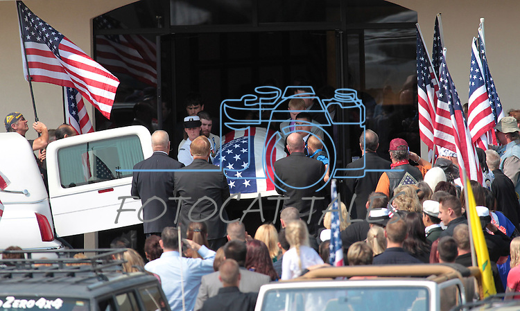 The body of Colorado shooting victim Jonathan Blunk leaves a Reno, Nev., mortuary following a memorial service Friday morning, Aug. 3, 2012. (AP Photo/Cathleen Allison)