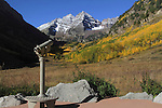 Telescope pointed to the Maroon Bells in autumn, Aspen, Colorado, John offers fall foliage photo tours throughout Colorado.