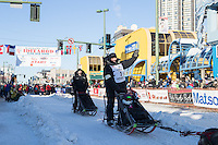 Otto Balogh and team leave the ceremonial start line with an Iditarider and handler at 4th Avenue and D street in downtown Anchorage, Alaska on Saturday March 4th during the 2017 Iditarod race. Photo © 2017 by Brendan Smith/SchultzPhoto.com.